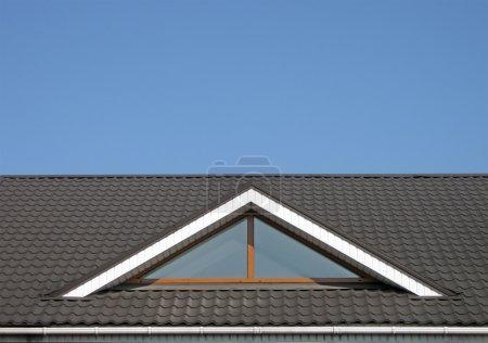 Brown tile roof construction, blue sky
