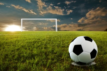Photo for Soccer ball on penalty disk in sunset time - Royalty Free Image
