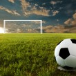 Soccer ball on penalty disk in sunset time
