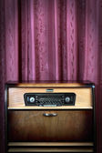 Old vintage radio on red background