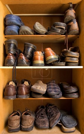 Photo for An old wooden shoes box with a lot of different footwear inside. - Royalty Free Image