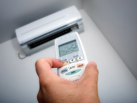 Photo for Closeup view about using some appliance such as air condition. - Royalty Free Image