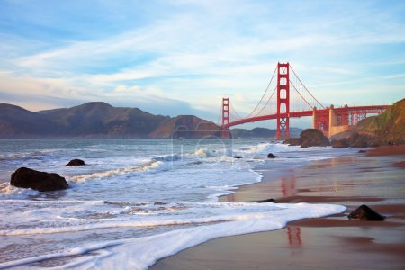Photo for Golden Gate bridge at sunset seen from Marshall Beach, San Francisco. - Royalty Free Image