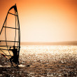 Windsurfer silhouette against a sunset background...