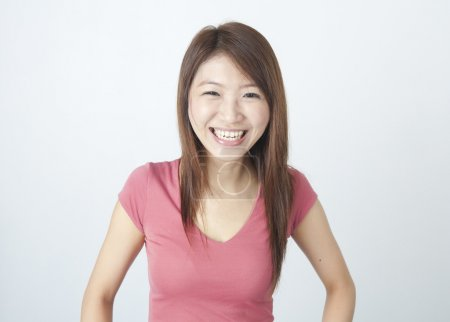 Photo for Portrait of an asian girl laughing in joy - Royalty Free Image
