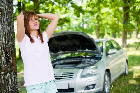 Photo for Desperate woman with a broken car in a forest waiting for help - Royalty Free Image