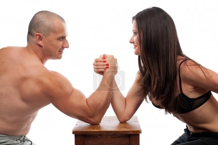 Photo for Strong man and woman doing arm wrestling isolated on white - Royalty Free Image