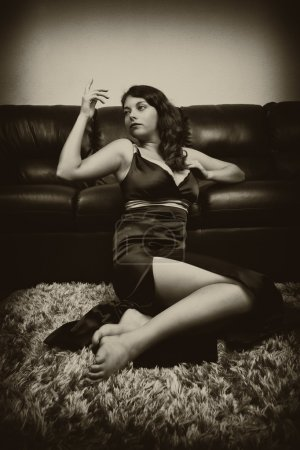 Photo for Vintage sepia stylized portrait of a beautiful woman near a couch - Royalty Free Image