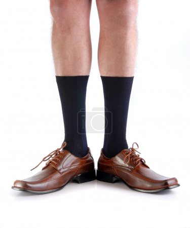 Legs from a man with open feet.