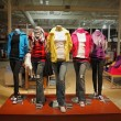 An empty teenage fashion store with five mannequin...