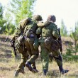 Two NATO Army soldiers escorted the wounded soldie...