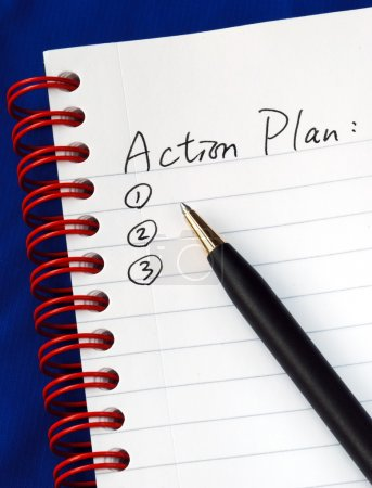 Photo for Prepare the action plan in a writing pad isolated on blue - Royalty Free Image