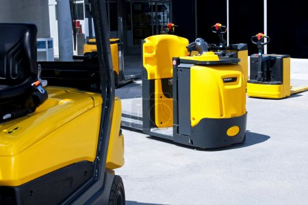 Yellow cargo pallet transporters and fork lifters...
