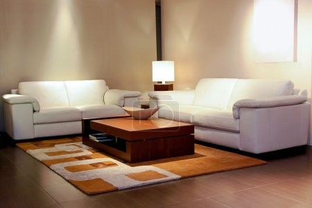 Photo for Tidy living room space with white leather furniture - Royalty Free Image