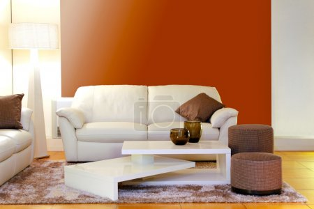 Photo for Modern white leather sofa with interesting coffee table - Royalty Free Image
