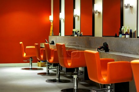 Photo for Modern empty hair saloon with chairs and mirrors - Royalty Free Image