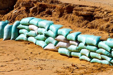 Photo for Sand bags barrier for water flood protection - Royalty Free Image