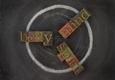 Photo for Wellness cycle concept (body, mind, spirit) - vintage wooden letterpress type blocks, white chalk drawing on blackboard - Royalty Free Image