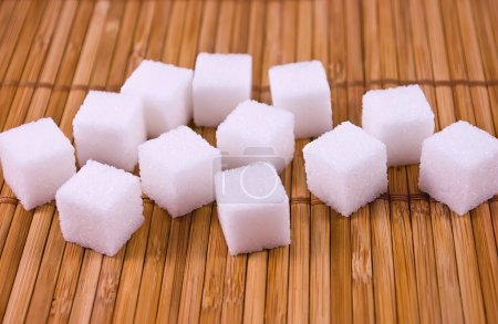 Photo for White sugar cubes on a placemat - Royalty Free Image