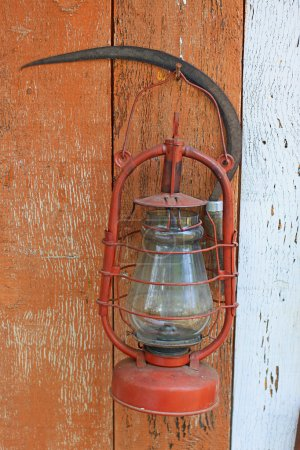 Kerosene lamp and sickle