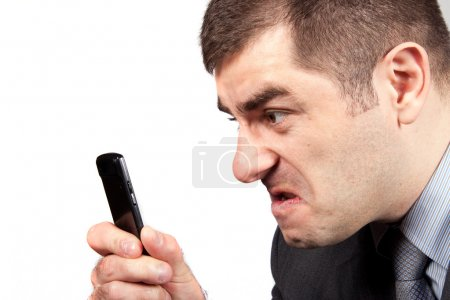 Stressed businessman screaming in telephone