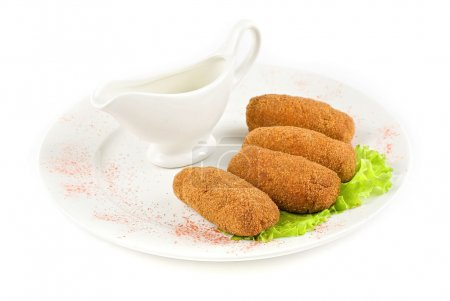 Photo for Roasted cutlets of meat and lettuce isolated on a white - Royalty Free Image