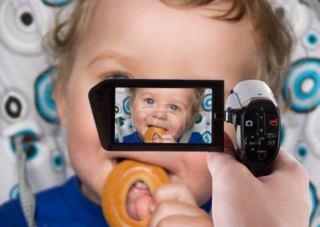 Baby boy recording to camcorder