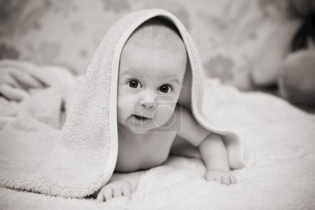 Photo for Baby after bath under towel - Royalty Free Image
