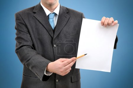 Man is holding a piece of blank white paper, busin...