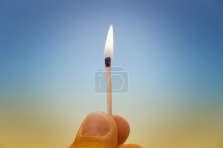 Hand with a match