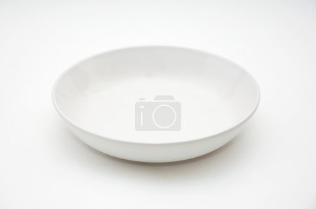 Photo for White empty plate over a white background. - Royalty Free Image