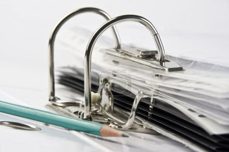 Binder with files and pencil
