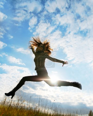 Playful woman jumping