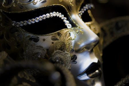 Part of venetian mask on black background