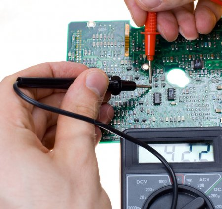 Photo for PCB diagnostics and measurement by means of a multimeter - Royalty Free Image