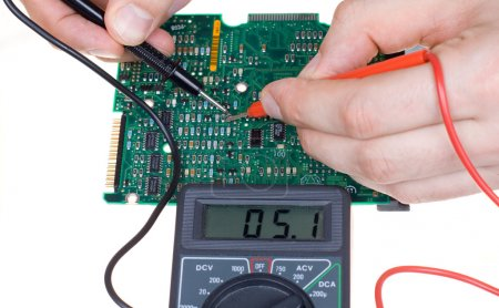 Photo for Printed circuit board and multimeter - Royalty Free Image