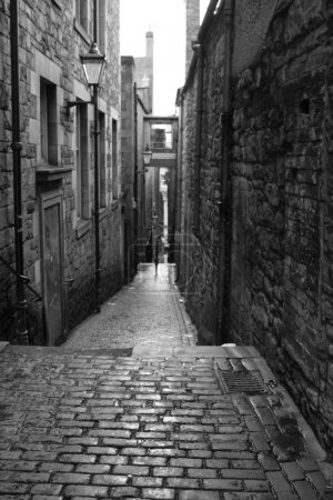 Photo for Old street by the Royal Mile in Edinburgh - black and white - Royalty Free Image