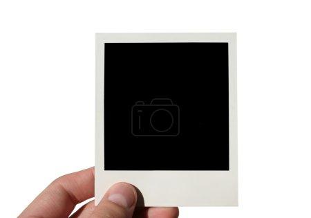 Female hand holding photo frame