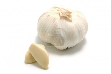 Photo for Fresh whole and pieces garlic over white background - Royalty Free Image