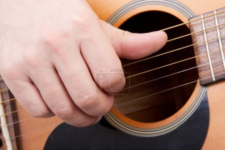 Photo for Hand is playing the guitar in closeup - Royalty Free Image