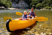 Father and daughter in canoe