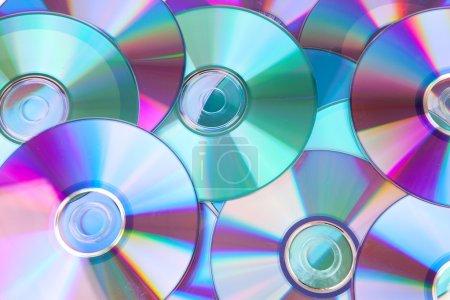 Photo pour Fond composé de disques compacts CD en gros plan - image libre de droit