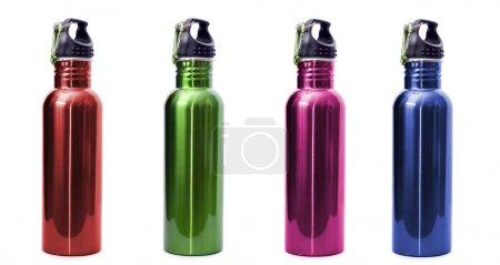 Photo for A set of four safe, reusable stainless steel water bottles isolated on white background in red, green, pink, and blue. - Royalty Free Image