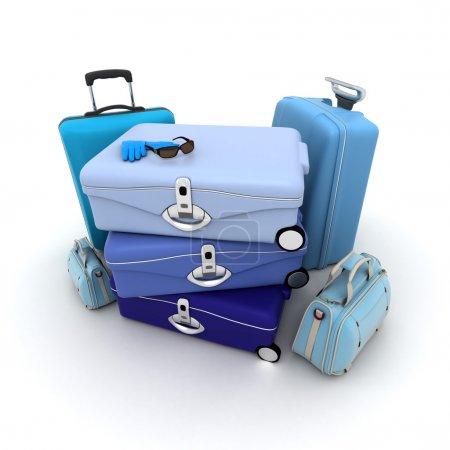 Photo pour Ensemble de bagages dans différentes nuances de bleu, avec lunettes de soleil et gants en cuir assortis sur le dessus - image libre de droit
