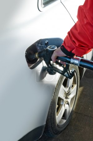 Man refilling petrol deposit