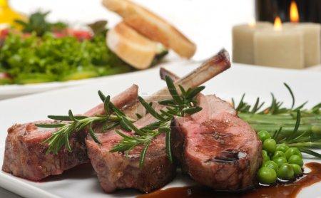 Lamb chop, salad and wine...