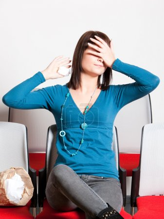 Scared woman covering eyes with hand