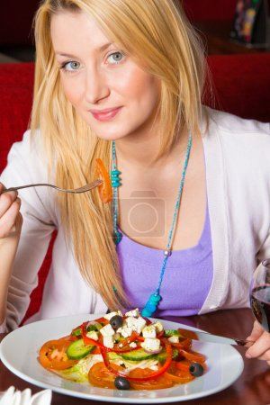 Young Woman Eating Dinner