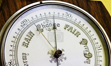 A close up image of an antique banjo barometer...