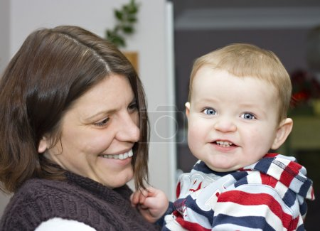 An adorable cute one year old boy with his mother